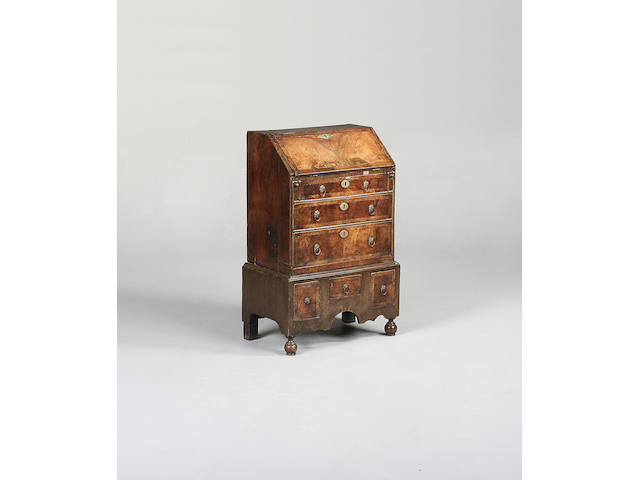 A small walnut and crossbanded bureau late 17th century and later