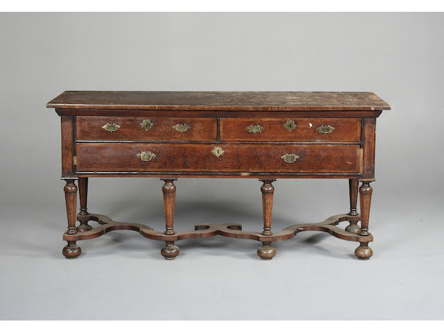 A Dutch walnut and burr sideboard