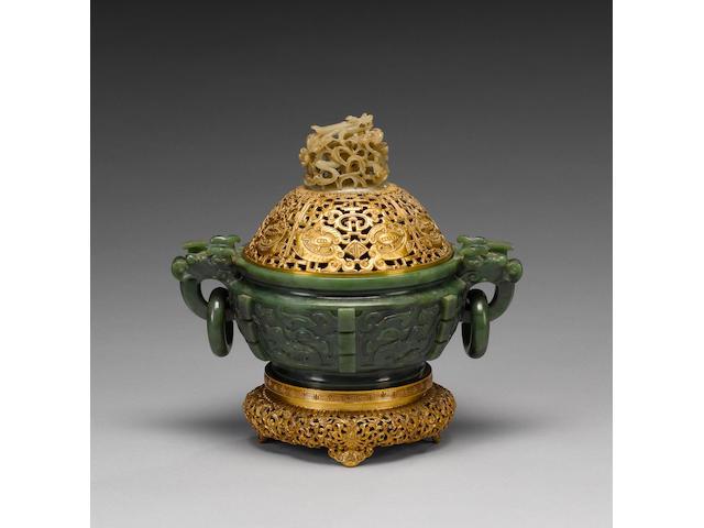 An elegant, mottled spinach-green jade bowl