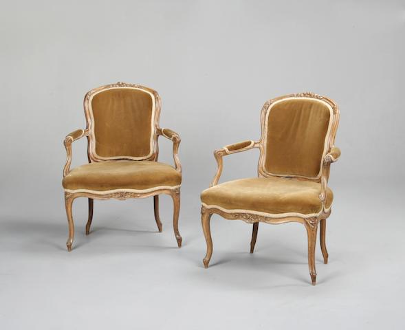 A pair of Louis XV beech fauteuils