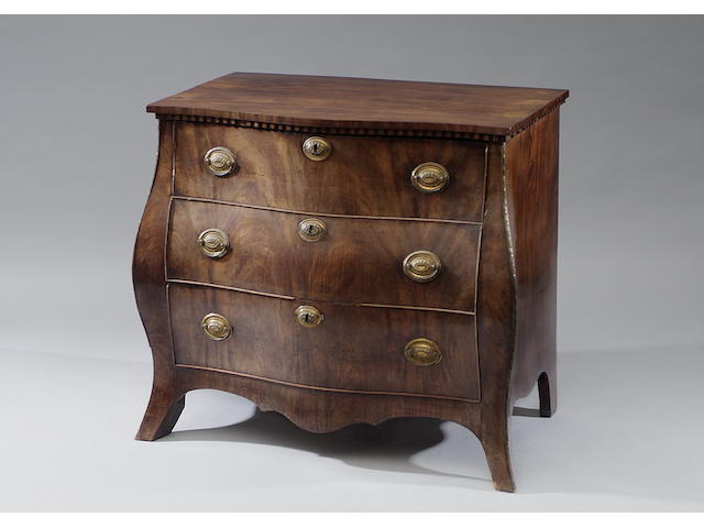 A late 18th Century Dutch mahogany bombe commode With dentil frieze above three long drawers, on swept bracket feet, 95cm wide.