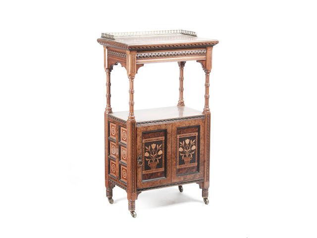A late 19th century Gillows Gothic Revival walnut music cabinet,