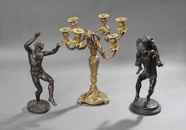 """A bronze figure after the antique """"Dancing Faun"""" And a companion bronze, 47cm high. (2)"""