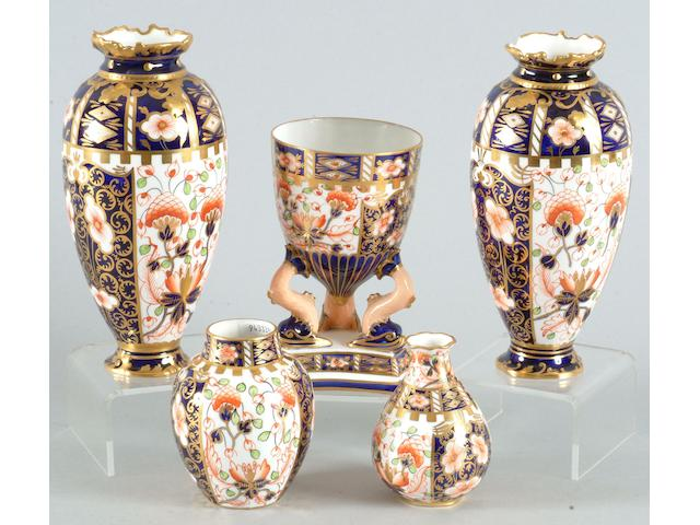 A collection of five Royal Crown Derby vases