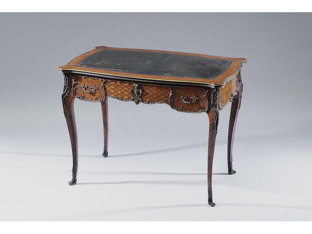 A late 19th Century Louis XV style tulip and rosewood veneered parquetry serpentine writing table Fitted with a frieze drawer to the front with dummy opposite, on cabriole legs, 102 x 64cm.