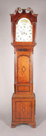 A late 18th/early 19th century oak, mahogany and inlaid longcase clock
