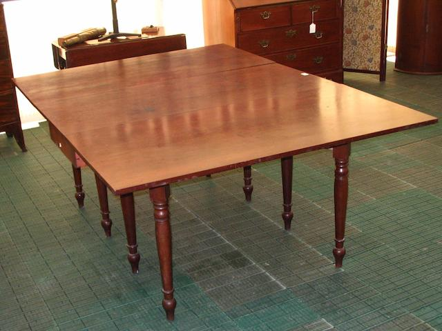 An early 19th Century mahogany dining table