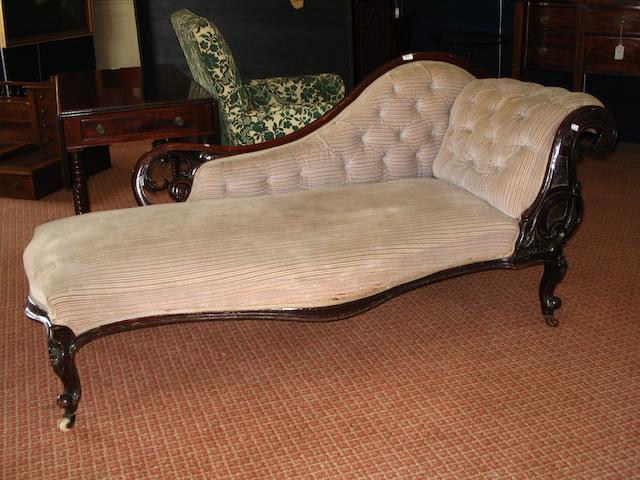 A Victorian mahogany chaise longue