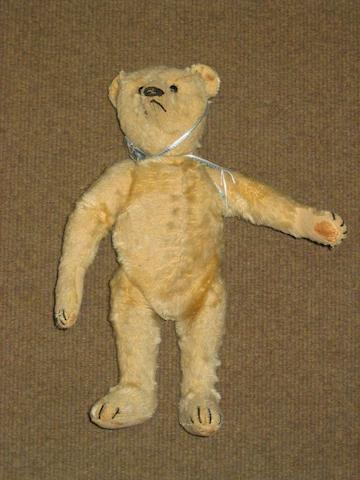 A small straw filled teddy bear,