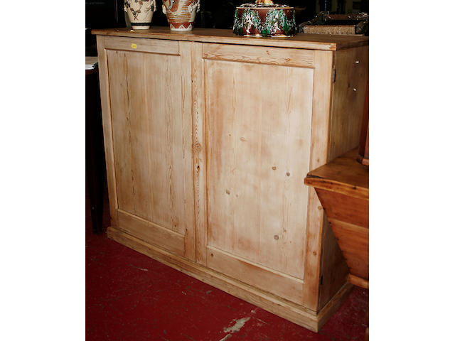 A 19th Century stripped pine cupboard