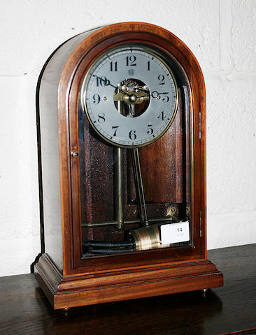 A 20th Century mahogany cased battery/coil mantel clock by Bulle