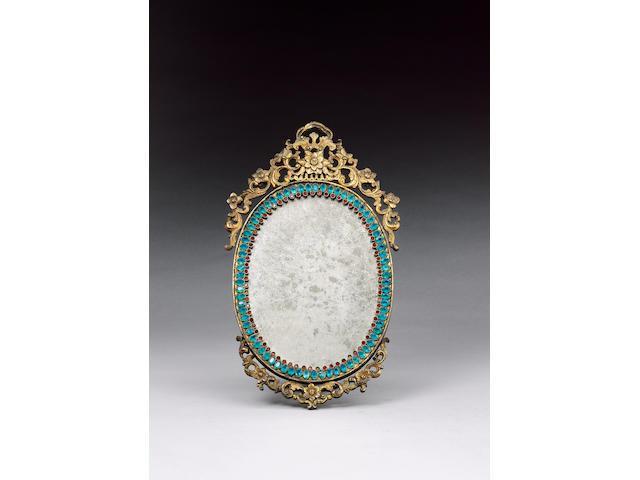 A gilt metal framed, oval mirror,