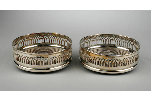 A pair of modern silver mounted  slice and hobnail cut glass decanters and stoppers London 1973,