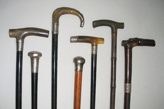 A group of three horn handled walking sticks