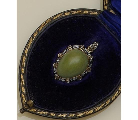 A Victorian gold mounted egg-shaped pendant
