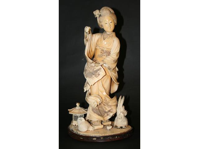A large ivory okimono of a Bijin, Meiji period
