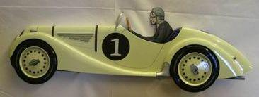 A hand painted wooden profile of a BMW 328 sportster,