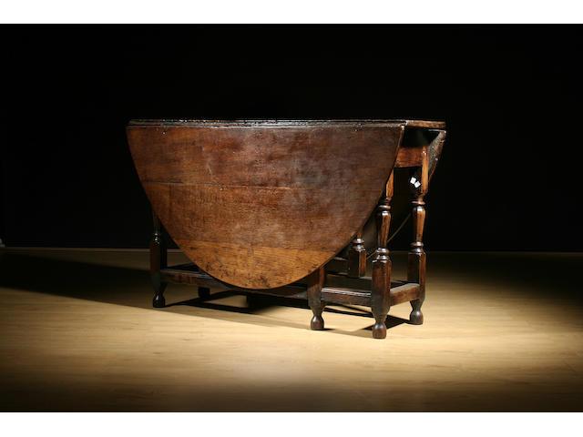 An early 18th Century oak gateleg table