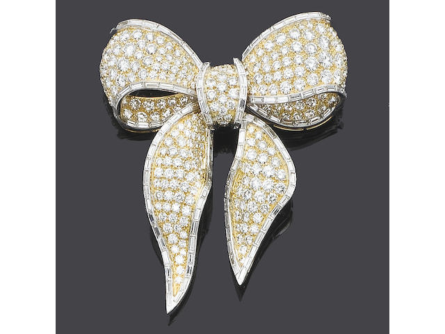 A diamond bow brooch/pendant, by Kutchinsky