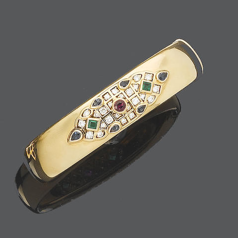 A diamond and gem-set hinged bangle, by Cartier