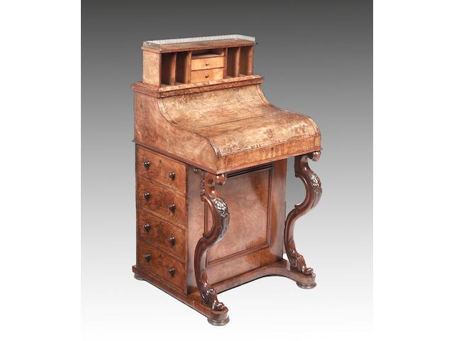 A mid Victorian walnut piano front pop up davenport