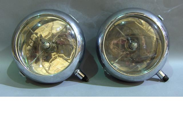 A good pair of Stephen Grebel headlamps, 1930s,