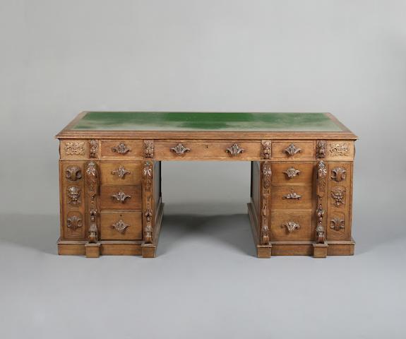 An unusual late Victorian oak partner's desk