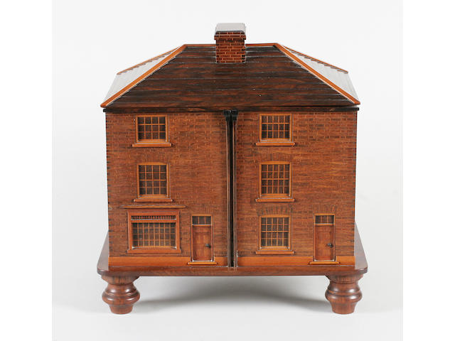 A unique and exceptional wooden work box in the form of a shop and house, circa 1835
