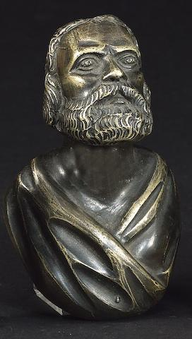A patinated bronze mask head of a bearded elder