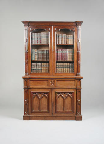 An early Victorian Gothic style mahogany secretaire bookcase