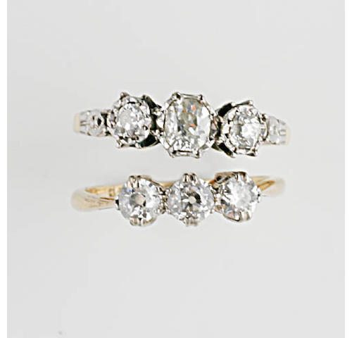 A three stone diamond ring, (2)