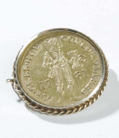 A Belguim gold coin,