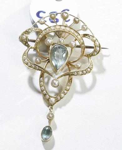 An Edwardian aquamarine and seed-pearl pendant/brooch