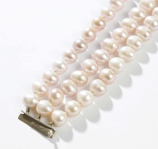 A three-row cultured pearl necklace