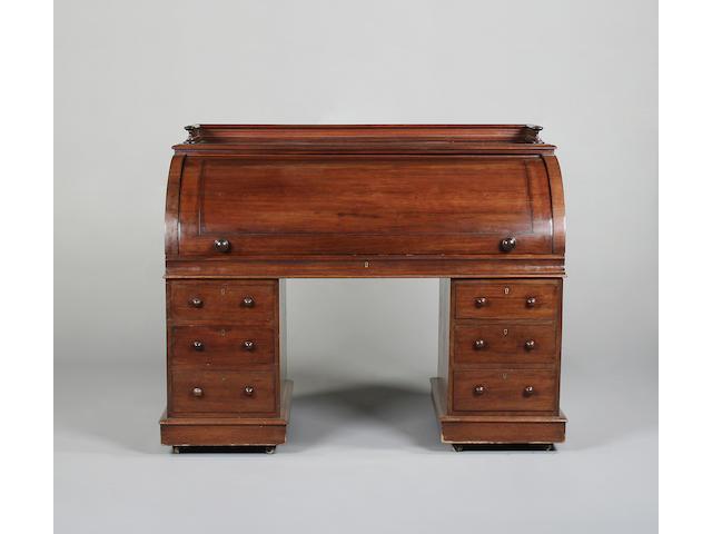 A Victorian mahogany cylinder pedestal desk