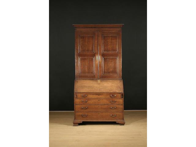 An 18th Century oak bureau cabinet