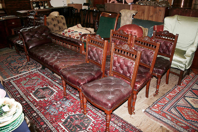 An Edwardian carved and spindle galleried oak drawing room suite,
