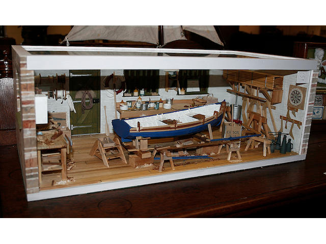 A highly detailed diorama of a boat builder's workshop,