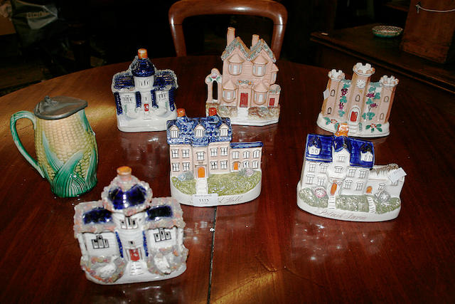 Six various Staffordshire cottage house and castle models,