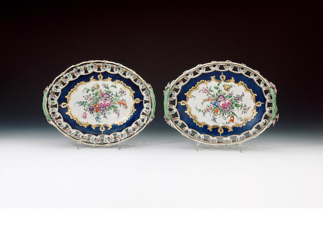 Pair of oval pierced baskets, scale blue and flowers