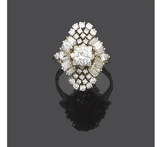 A diamond and laser drilled diamond cluster ring