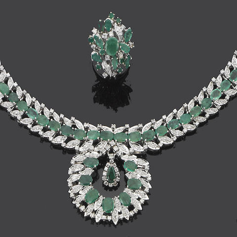 An emerald and diamond necklace, bracelet, ring and earring suite