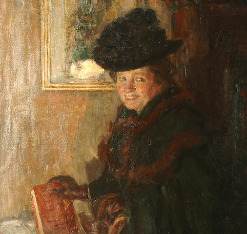 Belgian School, Early 20th Century A lady in an interior holding a book
