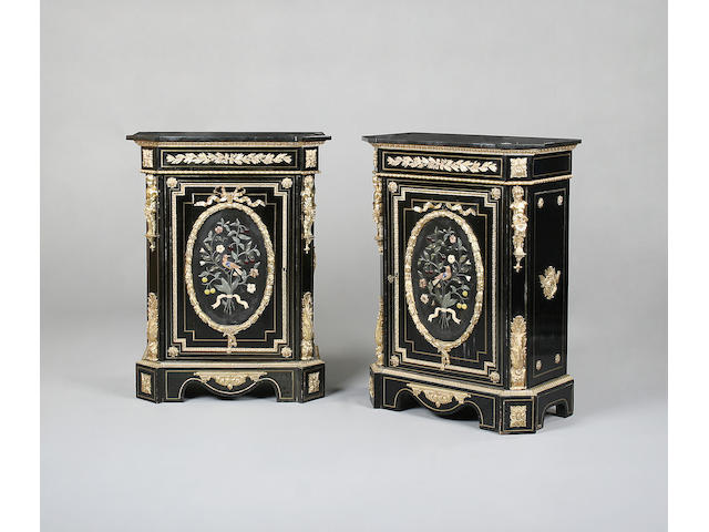 A pair of Napoleon III ebonised, gilt bronze and hard stone mounted meubles d'appui