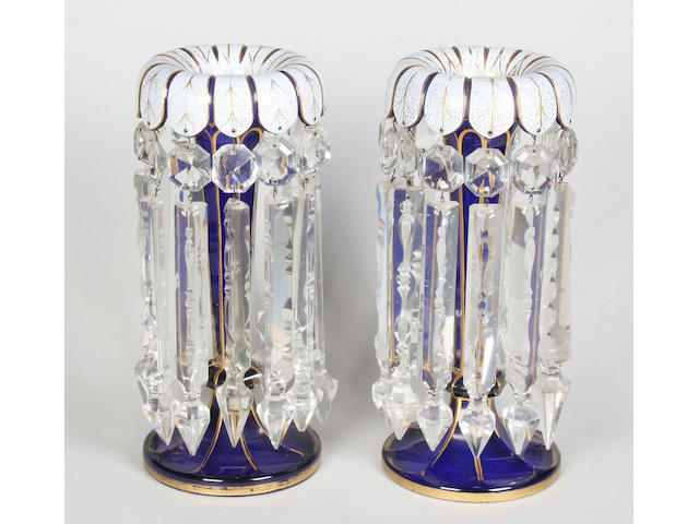 A pair of Bohemian blue and white overlay glass table lustres