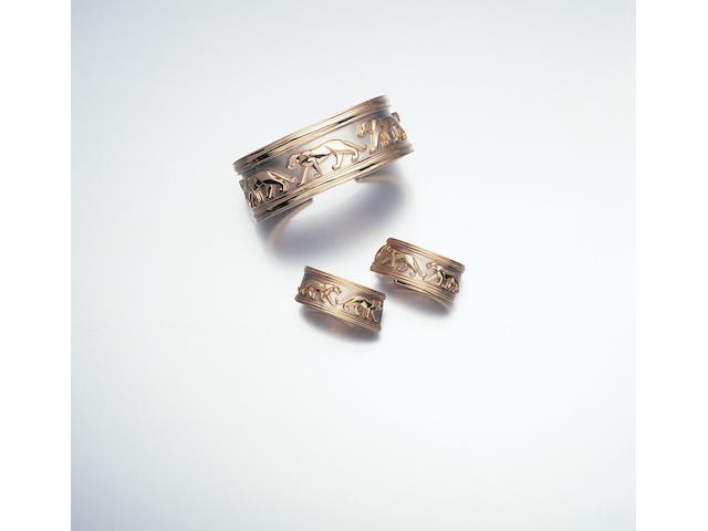 A panthère torque bangle and earclips, by Cartier