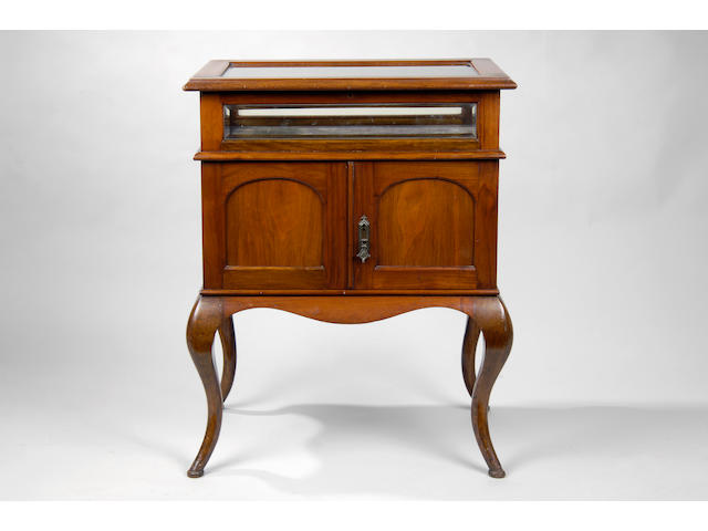 An Edwardian walnut curio table and coin collector's cabinet
