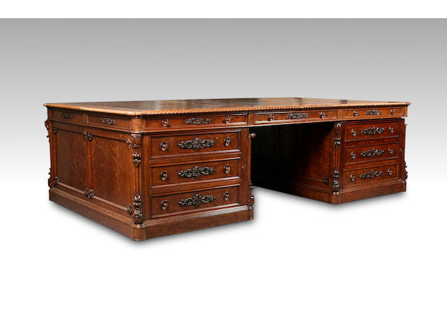 An impressive and large 19th century French satined walnut partner's pedestal desk