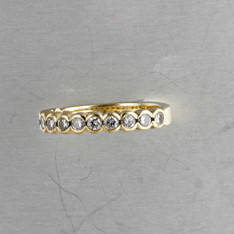 An 18ct gold diamond ring, by Theo Fennell