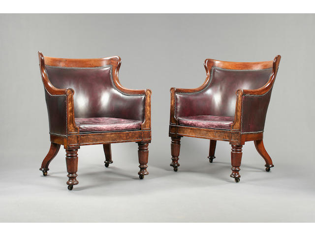 A pair of George IV mahogany library bergeres.